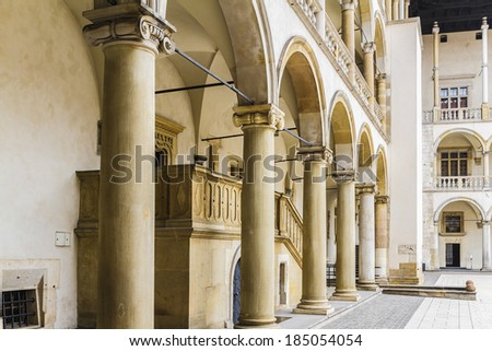 Fragment of Renaissance courtyard within Wawel Castle. Krakow, Poland. Castle was built at the behest of Casimir III the Great, who reigned from 1333 to 1370. - stock photo