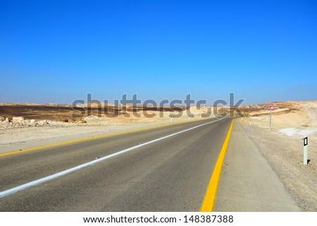 Fragment of road in the desert. - stock photo
