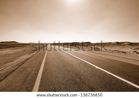 Fragment of road in the desert. Sepia - stock photo