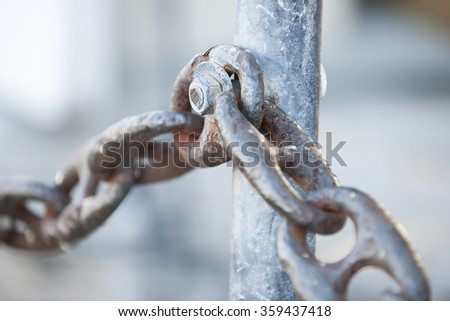 Fragment of rusty metal chain railing in Key West harbor, Florida. - stock photo