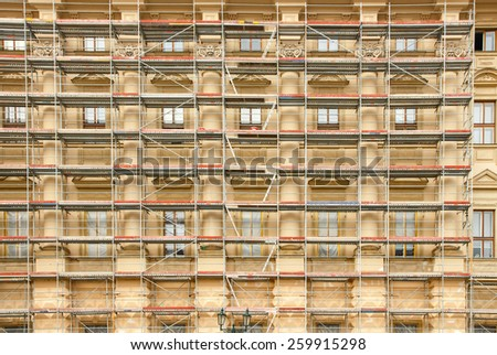 Fragment of scaffolding during the restoration of the old house in Prague. - stock photo
