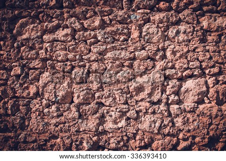 Fragment of stone texture wall or fence for natural background. Closeup detail. Toned.