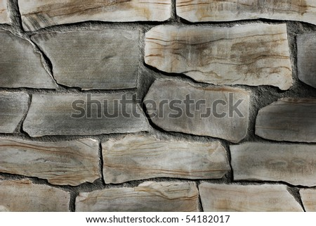 Fragment of stone wall. Abstract background - stock photo