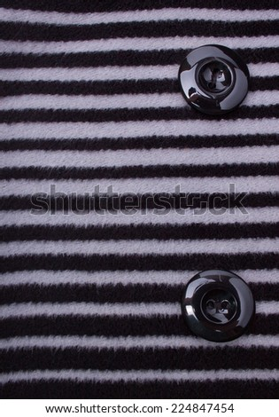 Fragment of Striped Coat with Black Buttons - stock photo