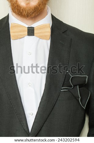 Fragment of suit. Wooden bow tie festive attire - stock photo
