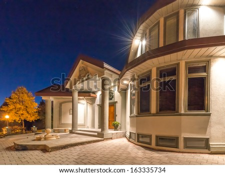 Fragment of the big luxury house at night, disk, sunset, sunrise time in suburbs of Vancouver, Canada. - stock photo