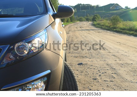 fragment of the car on the road crossover SUV