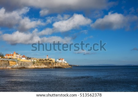 Fragment of the cityscape with the historical buildings and the beach on Atlantic ocean in Estoril, Portugal.