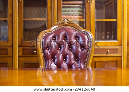 Fragment of the interior of the working cabinet with a library. - stock photo