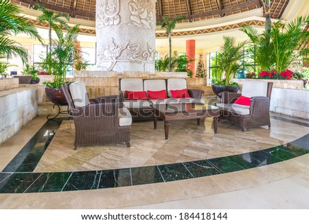 Fragment of the lobby, lounge area with some chairs and table of five stars luxury caribbean resort hotel. Interior design. Bahia Principe, Riviera Maya, Mexico.