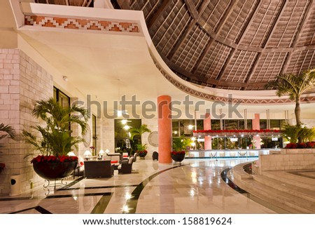 Fragment of the lobby of the five stars luxury caribbean resort hotel. Lounge area. Interior design. Bahia Principe, Riviera Maya, Mexican Resort. - stock photo
