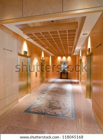 Fragment of the lobby of the luxury five stars hotel with the elevators segment. - stock photo