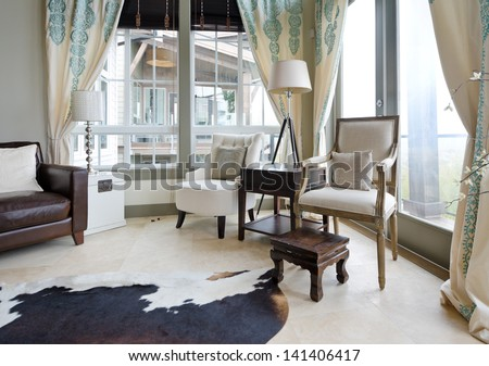 Fragment of the luxury spacious modern room with two coaches and the lamp. Interior design. Vertical.