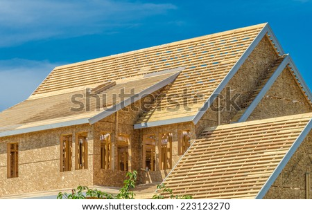 Fragment of the new residential home under construction, roof framing. North America. - stock photo
