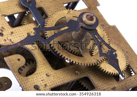 Fragment of the Old clockwork mechanism - stock photo