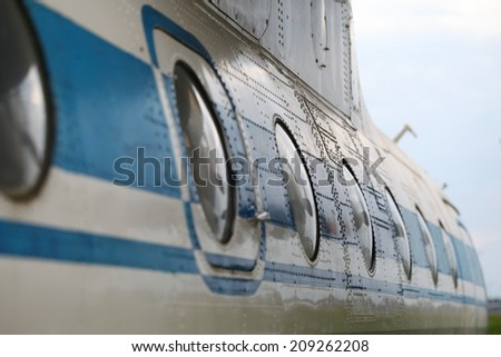 fragment of the old Soviet aircraft. vertical shot - stock photo