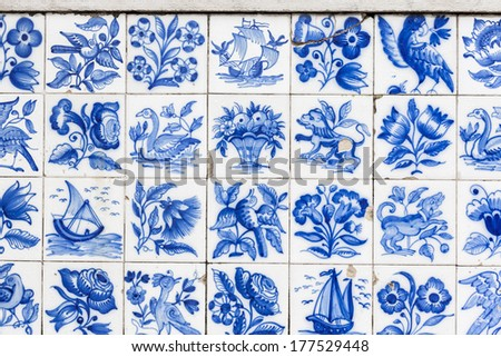 Fragment of the old wall in Lisbon, Portugal. Azulejo is a typical aspect of Portuguese culture, having been produced without interruption for five centuries. - stock photo
