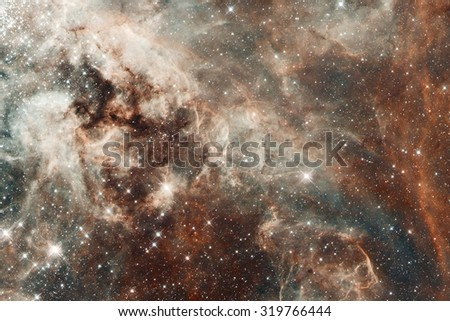 Fragment of the region 30 Doradus lies in the neighboring Large Magellanic Cloud galaxy. Retouched image. Elements of this image furnished by NASA. - stock photo
