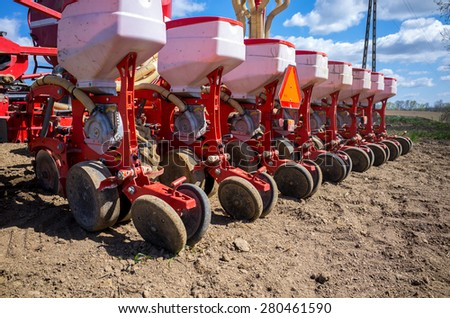 Fragment of the sowing equipment on the field - stock photo