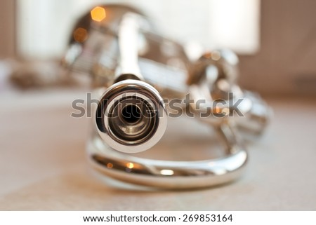 Fragment of the trumpet closeup on blurred background - stock photo
