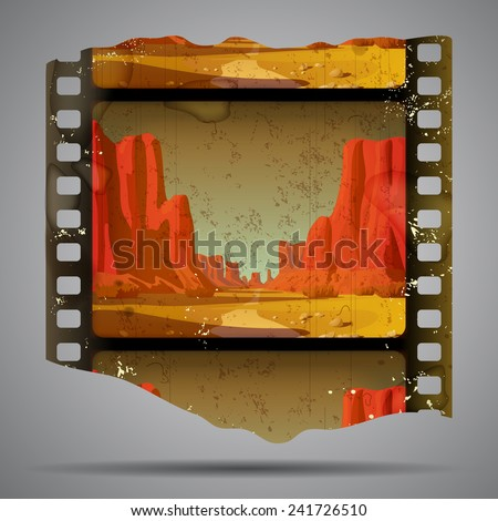 Fragment of vintage western film strip with big canyon - stock photo