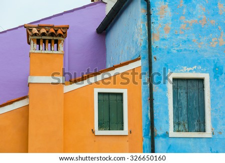 Fragment of walls of the houses painted with bright color paints on Burano's island, Venice, Italy