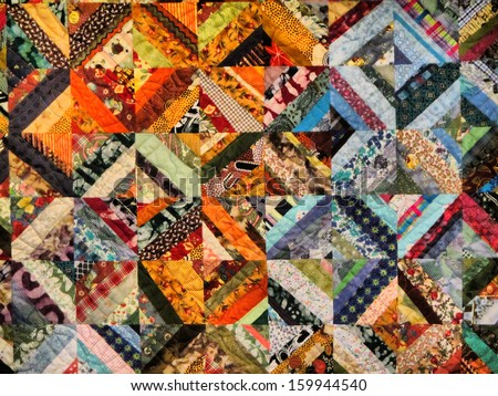 Fragment of warm-toned traditional carpet or blanket.  - stock photo
