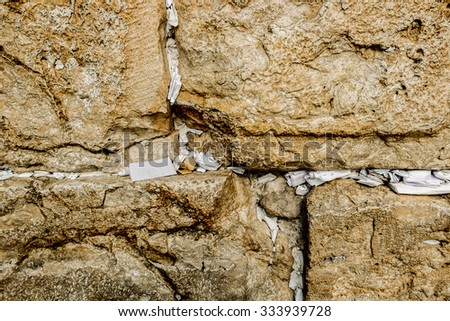 Fragment of Western Wall with sticky notes in Jerusalem Israel - stock photo