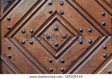 Fragment of wooden door with metal rivets in Prague