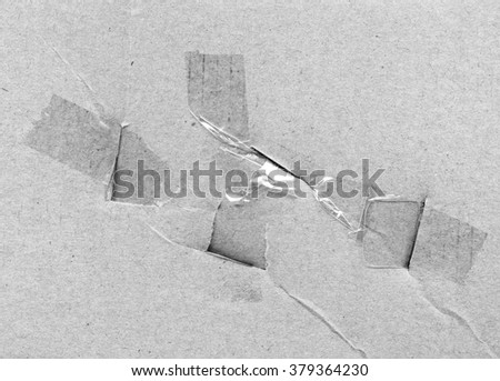 fragment used gray wrapping paper and adhesive tape
