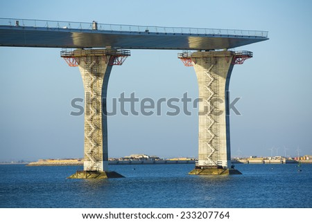 Fragment view of the road under construction over the sea - stock photo