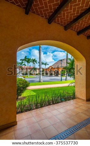 Fragment with the arch of urban architecture of caribbean, tropical style gallery, building, hotel.