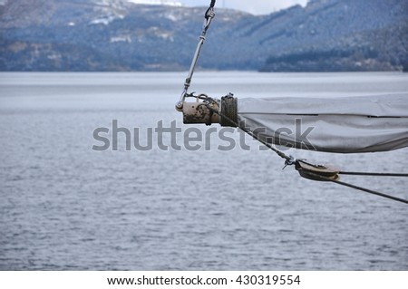 Fragmentary view details of knots and ropes on the sailboat mast in the lake, Pulley Sailing Ropes and detail, Masts of the old sailing ship - stock photo