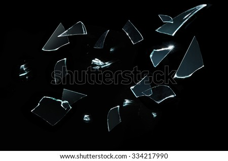 Fragments glass crashed with motion - stock photo