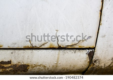 Fragments of an old, abandoned, rusty, romanian car - paint and rust textures - stock photo