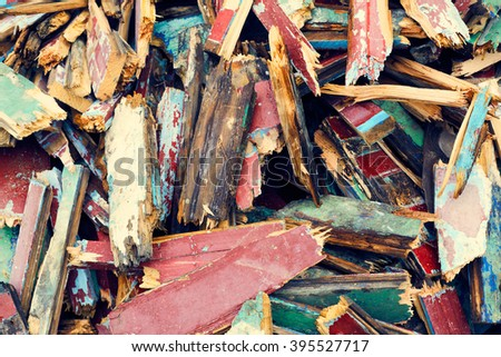 Fragments of old painted broken wooden colorful planks boards kindling texture background