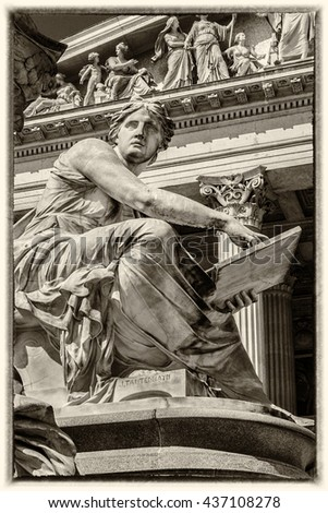 Fragments of the Pallas Athena fountain, in front of the Austrian Parliament Building. The figures symbolize the rivers Danube, Inn, Elbe and Moldau. Vienna, Austria, Europe. Style an ancient photo.