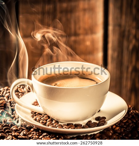 Fragrance coffee cup with roasted grains - stock photo