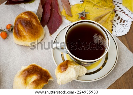 fragrant biscuits and apples with a cup of tea - stock photo