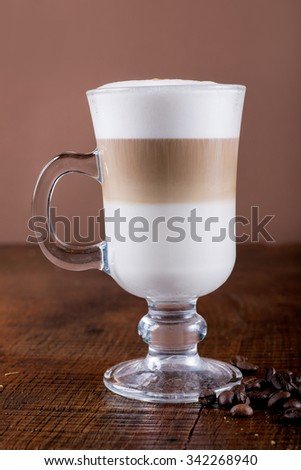 Fragrant coffee on wooden background