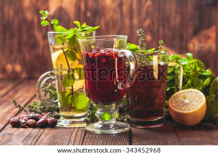 Fragrant herbal tea with thyme, mint, cranberry, lemon for healthy in winter - stock photo