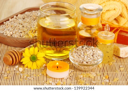 Fragrant honey spa with oils and honey on wooden table close-up