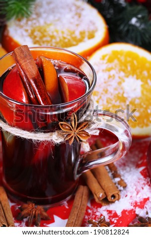 Fragrant mulled wine in glass on napkin close-up