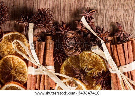 Fragrant, natural Christmas decorations for a plastic-free tree: cinnamon sticks, dried orange slices, pine cones, fir cones, star anise. - stock photo