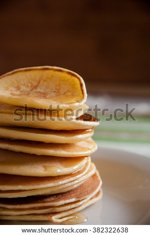 fragrant pancakes for breakfast with a spoonful of honey flavored