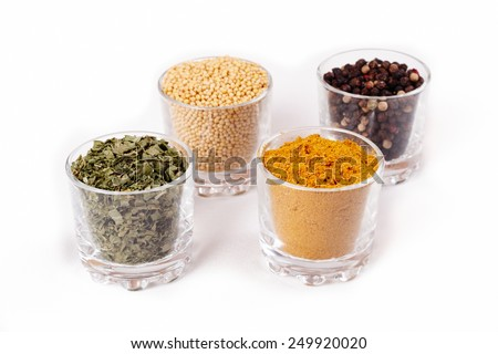 Fragrant spices. Isolated on white - stock photo