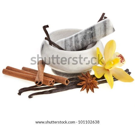 Fragrant spices with mortar isolated on white background