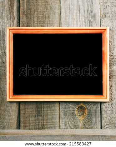 Frame and a wooden shelf. On a wooden background.