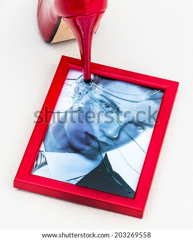 frame and high heels. symbolic photo for divorce, separation and relationship crisis - stock photo