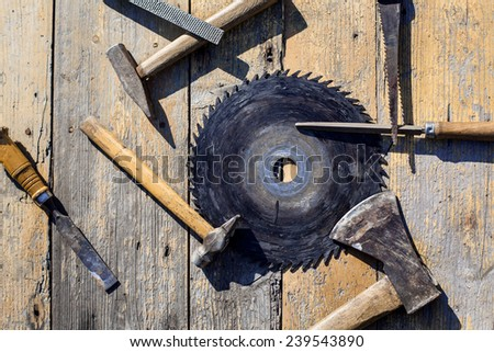 frame background with an axe, hammer, nail file and  plate - stock photo